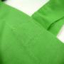 Baumwolltasche in frischem Grün mit weißem Siebdruck in Nahaufnahme