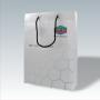 """Exklusive Kunststofftasche """"Equate"""" aus milchig-transparentem Material und schwarzen Tragekordeln"""
