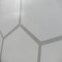 """Exklusive Kunststofftasche """"Equate"""" aus milchig-transparentem Material und schwarzen Tragekordeln in Nahaufnahme"""