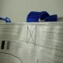 PP Woven Tasche mit langen Trageschlaufen und Flexo-Druck in Nahaufnahme