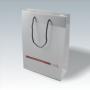 Transparente Papiertasche mit braunem Aufdruck